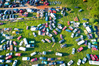 Car wrecks on meadow aerial view