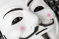 Computer hacker mask and keyboard
