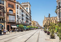Street with rails for tram in the city center of Seville