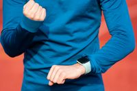 Successfully Runner Looking At Heart Rate Monitor Smart Watch, close up.