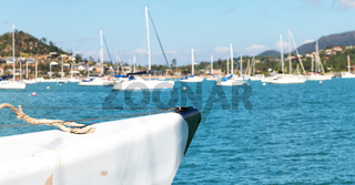 sailing with catamaran prow in the ocean and harbor