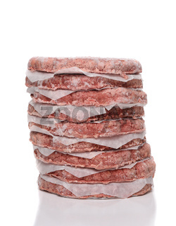 A stack of frozen hamburger patties isolated on white with reflection.