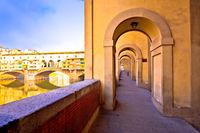 Arno river coastline and Ponte Vecchio bridge in Florence view