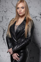 Pretty blonde woman posing in studio