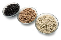 Beans are black, brown and white in glass bowls