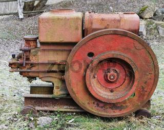 Rusty  vintage  small  tractors  diesel engine  in forgotten village.
