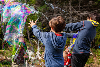 Children playing with bubbles in nature