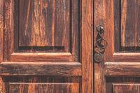 old  wood door closeup with metal knob -
