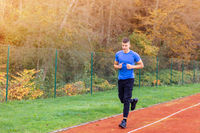 Man running on the race track