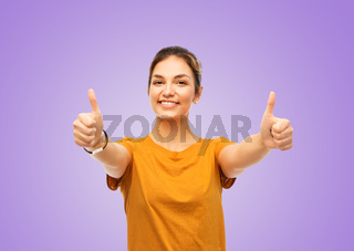 teenage girl in t-shirt showing thumbs up