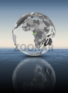 Gabon on translucent globe above water