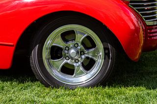 Old classic American red car wheel