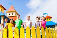 Schoolchildren on the playground in the summer outdoors