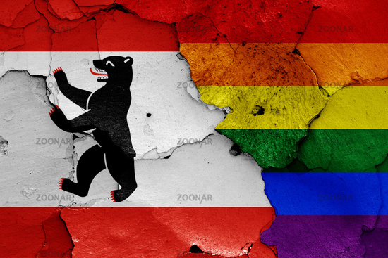 flags of Berlin and LGBT painted on cracked wall