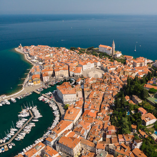 Aerial view of old town Piran, Slovenia, Europe. Summer vacations tourism concept background.