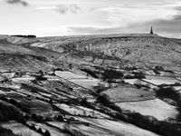 snow covered landscape with fields and moors near stoodley pike in west yorkshire.
