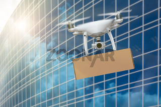 Unmanned Aircraft System (UAS) Quadcopter Drone Carrying Blank Package Near Corporate Building