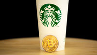 Bitcoin with Starbucks cup