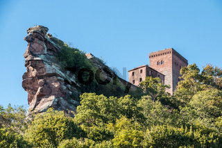 Big rocks, old castle and high tower made of sandstone