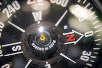close up of a naval compass with bokeh