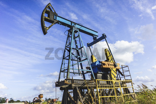 Production of Oil: Oil Rig on Blue Sky Background