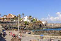 Holiday makers swimming near the harbour, Puerto De La Cruz, Tenerife
