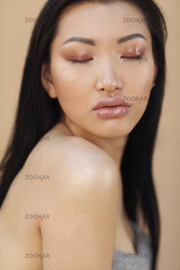 Beautiful asian model with long dark hair