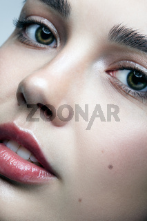 Closeup macro portrait of female face. Woman with natural beauty makeup