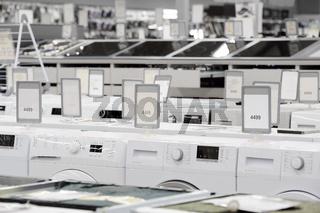 washing mashines in appliance store showroom