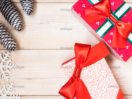 Wrapped gift boxes on the wooden board. Christmas and New year concept