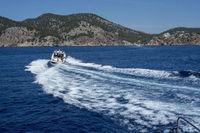 Motor boat speeding making foamy waves