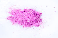 Pile of pink powder isolated on white background.