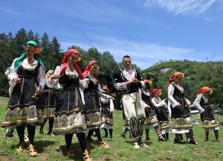 Vratsa, Bulgaria - June 24, 2018: People in traditional authentic folklore costume a meadow near Vratsa, Bulgaria