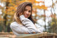 Woman portrait in autumn color. Brunette woman portrait in autumn color.