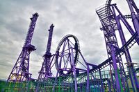An attraction roller coaster shot from below