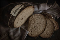 Sliced homemade rye bread. Kitchen table flat lay image