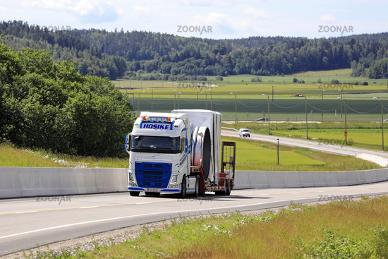Road Landscape with Oversize Load Transport