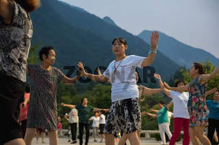 Group of Chinese women dancing in the evening