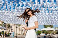 Beautiful woman young brunette wear in white dress