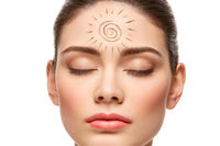 girl with sun drawing on forehead isolated on white