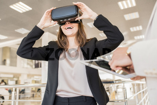 Modern Young Woman Wearing VR Helmet