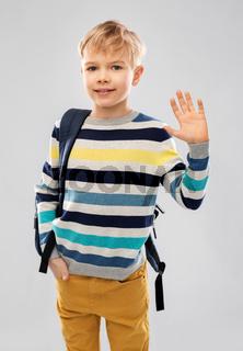 smiling student boy or schoolboy with school bag