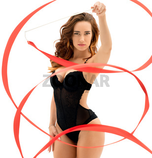 Gorgeous female gymnast dancing with ribbon
