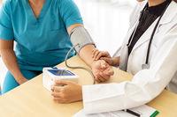 Doctor examine senior woman