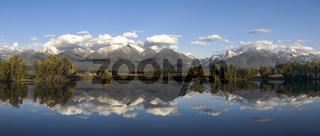 Panorama of a pond and mountains in Montana.