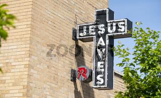 Neon Jesus Saves Sign Brick Wall Church Exterior