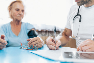 Senior woman during a medical exam with her practitioner
