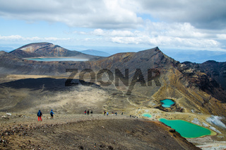 View of Emerald lakes from Tongariro Alpine Crossing hike with clouds above, North Island, New Zealand