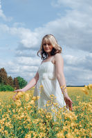 woman with a white dress in a rape field