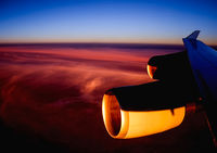 View of the sunset from the airplane porthole.